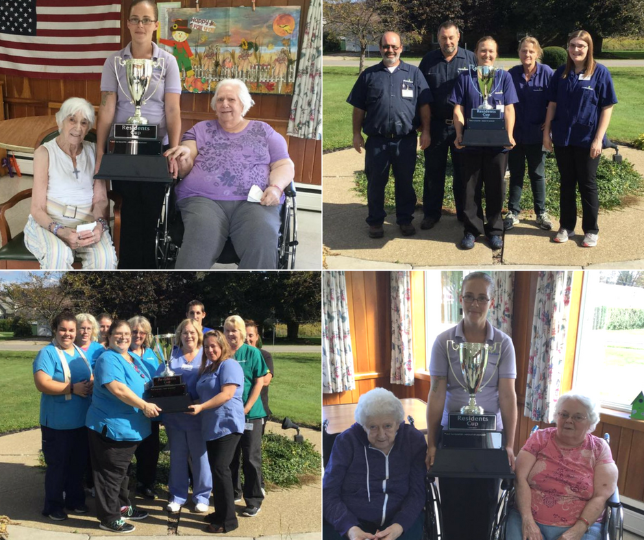 Residents and Staff Pose with Cup