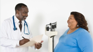 doctor providing bariatric care to obese patient
